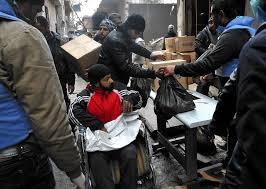 """Distribuzione di cibo. Le ogranizzazioni internazionali non attraversano i confini senza il permesso del regime, che nega il permesso se i destinatari non sono """"lealisti"""" al regime."""